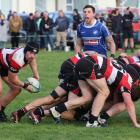 Midland No8 Sam Brame looks to move the ball while Wyndham halfback Tyrone Braven alerts his team...