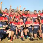 The Cromwell Goats celebrate winning the Central Otago club title at Anderson Park in Cromwell on...