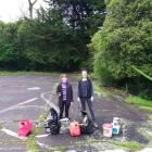 Miss Moss-Mason (left) and club secretary Ashlee Drummy display rubbish recovered from a site...