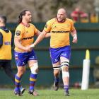 Josh Hayward (right) is congratulated by North Otago team-mate Taina Tamou after scoring his side...