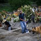 Cemetery workers dig new graves at the Xico cemetery on the outskirts of Mexico City. Photo: Reuters