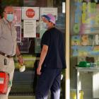 Medical personnel outside an aged care facility in Melbourne yesterday. Photo: Reuters