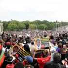 """Demonstrators at the Lincoln Memorial for the """"Get Your Knee Off Our Necks"""" march in Washington,..."""