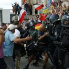 Police scuffle with a protester in front of the Reichstag Building during a rally against the...