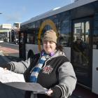 Amanda Corbett checks her schedule at the Dunedin Bus Hub, in Great King St, as she takes part in...