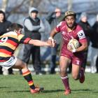 Alhambra-Union fullback Vilimoni Koroi brushes aside Zingari-Richmond halfback Logan Crowley at...