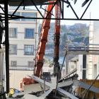 Part of the canopy of the former Cadbury warehouse is pulled down on Saturday, as work begins on...