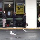 Shoppers queue at Dunedin Central Countdown yesterday. PHOTOS: PETER MCINTOSH