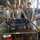 Admiring their pig at last year's New Zealand Agricultural Show are (from left) Tom Reed, Jamie...