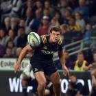 Highlanders loose forward Dillon Hunt looks for the ball while playing against the Rebels at Forsyth Barr Stadium last month. Photo by Peter McIntosh.