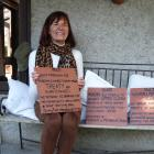Millennium path campaigner Liz Hall shows new tiles ready to replace damaged tiles along the...