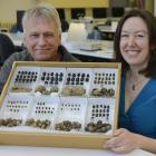 Henrik Moller and Emma Curtin with a sample of beetles and their dung creations. PHOTOS: GERARD O...