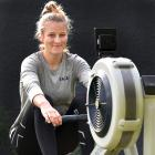 Eva Hofmans on her rowing machine at home. PHOTO: PETER MCINTOSH