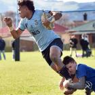 King's High player Joji Buli is tackled by Southland Boys' Gareth Turnock during their Otago...