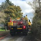 A rural Fire and Emergency New Zealand crew at the scene of the house fire near Waikouaiti. Photo...