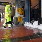 Dave Mitchell (right) and Tony Vaas sandbag shops in Mosgiel during a November 2018 flood. PHOTO:...