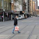 A man in a mask on a central Melbourne street. Photo: Getty