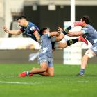 Ngatungane Punivai pulls off a spectacular offload as the Highlanders thrashed the Hurricanes at...