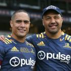 Highlanders Aaron Smith (150 games) and Ash Dixon (100 games) after the match. PHOTO: GETTY IMAGES