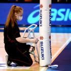 A staff member sanitises the goalpost before the ANZ Premiership final at  Stadium Southland in...