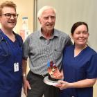 Semi-retired East Taieri farmer John Parks (78) talks to Dunedin Hospital cardiologists Dr Ben...