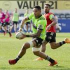 Highlanders loose forward Shannon Frizell looks to pass the ball while he is chased by reserve...