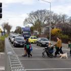 Pedestrians on SH76/Brougham St using a crossing near Addington School. Photo: Geoff Sloan