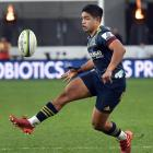 Highlanders' first five-eighth Josh Ioane puts a kick through during the side's game against the...