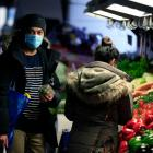 People are seen wearing face masks while shopping at the Queen Victoria Market in Melbourne....
