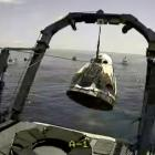 A capsule with Nasa astronauts Robert Behnken and Douglas Hurley is lifted out of water in the...