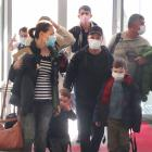Travellers on a flight from Auckland arrive at Queenstown Airport yesterday. PHOTO: HUGH COLLINS