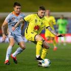 Wellington Phoenix forward Gary Hooper controls the ball during their match against the Brisbane...