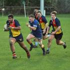 Possibles prop Sepa Vaka heads up field chased by Slade McDowall, while in support are Taylor...