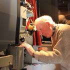 Regent Theatre projectionist Russell Campbell takes care of some maintenance on the theatre's...