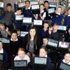 St Brigid's School teacher Emily Gillan (centre) has taught her years 5 and 6 class how to create...