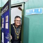 "Dunedin Mayor Dave Cull peeks out of ""the Turdis"", Waitati's new public toilet, following a..."