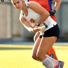 University Huskies player Brooke Craig looks to move the ball on while City Highlanders' player...