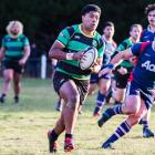 Woodlands centre Tevita Latu looks to get away from Woodlands hooker Jason Rutledge at a match at...