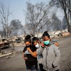 Sandra, Daniela, and Ester Reyes lost their trailer home after the wildfires destroyed a...