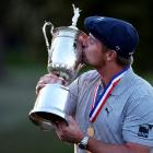 Bryson DeChambeau celebrates with the trophy after winning the US Open. Photo: Danielle...