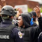Police stand guard in Louisville as a large crowd gathered to protest against racial injustice....