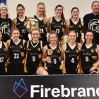 The Ajax players and supporters celebrate after winning the Dunedin women's club basketball...