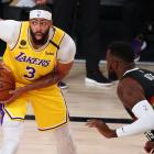 Los Angeles Lakers forward Anthony Davis prepares to drive on Denver Nuggets' forward Paul...