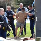 Police arrest a man in Memorial Park, Mosgiel, yesterday, after he allegedly assaulted a...