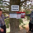 Hakatere residents Dennis Gant and Robert Mann with signs to be used when the new predator...