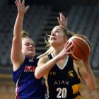 Ajax forward Zoe Richards looks to score as Falcons Kavanagh guard Annalise Wilson defends her...