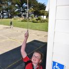 Port Chalmers School pupil Jimmy Hill (9) rings the school bell at 1pm yesterday to herald the...