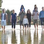 Otokia Creek and Marsh Habitat Trust members, with family members in tow, Dennis Kahui (left),...