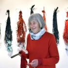 Auckland artist Christine Hellyer holds one of the paddles made from South Island stone she...
