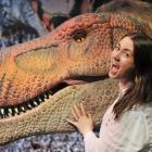 Otago Museum exhibition and creative services officer Shanaya Allan shows off the animatronic...